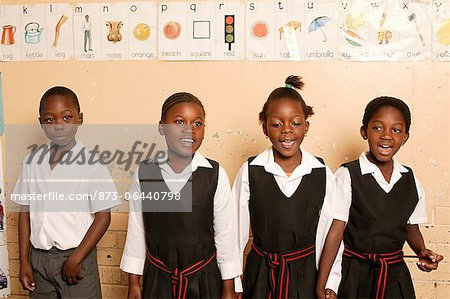 Four Students in a Line Stock Photo - Rights-Managed, Image code: 873-06440798