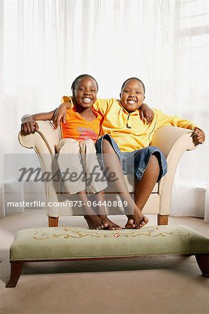 Children Sitting in Chair Stock Photo - Rights-Managed, Image code: 873-06440809