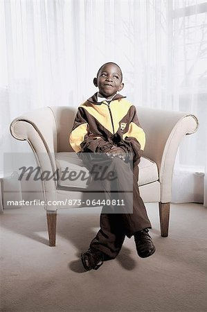 Boy Sitting in Chair Stock Photo - Rights-Managed, Image code: 873-06440811
