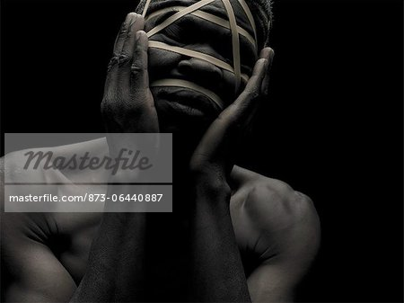 Man with Face Wrapped in Elastics Stock Photo - Rights-Managed, Image code: 873-06440887