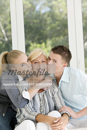 Young couple kissing mature woman Stock Photo - Rights-Managed, Image code: 877-06832449