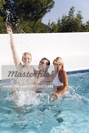 Mature couple and young woman playing in a pool Stock Photo - Rights-Managed, Image code: 877-06832488
