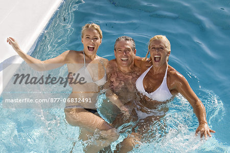 Mature couple and young woman in a pool Stock Photo - Rights-Managed, Image code: 877-06832491