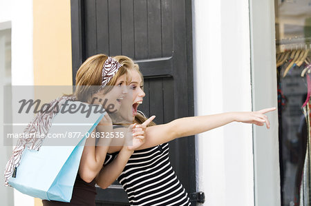 Two young women looking at show window Stock Photo - Rights-Managed, Image code: 877-06832535