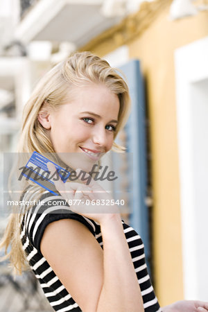 Portrait of a young woman holding a credit card Stock Photo - Rights-Managed, Image code: 877-06832540