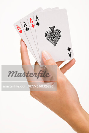 Woman's hand holding four playing cards (ace) Stock Photo - Rights-Managed, Image code: 877-06832650