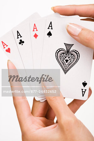 Woman's hand holding four playing cards (ace) Stock Photo - Rights-Managed, Image code: 877-06832652