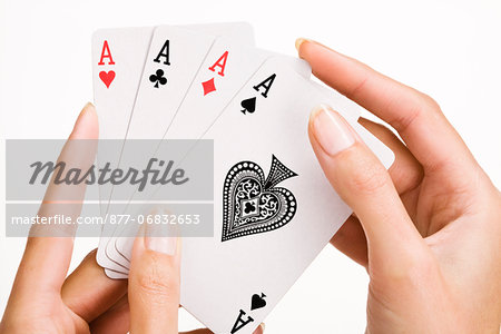 Woman's hand holding four playing cards (ace) Stock Photo - Rights-Managed, Image code: 877-06832653