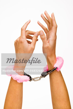 Woman's hands wearing fur handcuffs, close-up Stock Photo - Rights-Managed, Image code: 877-06832683