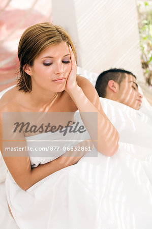 Young couple in bed Stock Photo - Rights-Managed, Image code: 877-06832861