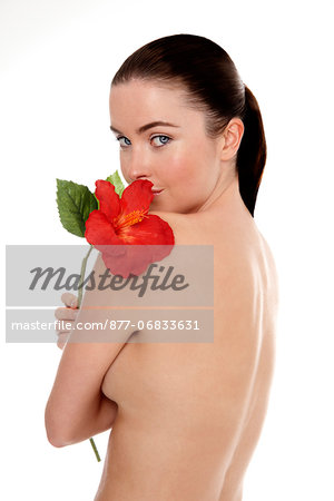 Naked woman with flower on her shoulder Stock Photo - Rights-Managed, Image code: 877-06833631