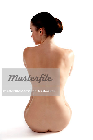 Naked woman sitting on floor Stock Photo - Rights-Managed, Image code: 877-06833670