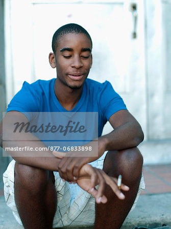 Teenager smoking Stock Photo - Rights-Managed, Image code: 877-06833898