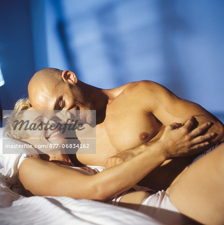 Lovers in bed Stock Photo - Rights-Managed, Image code: 877-06834162