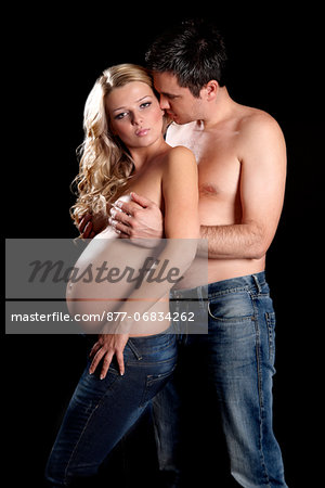 Man embracing topless pregnant woman Stock Photo - Rights-Managed, Image code: 877-06834262