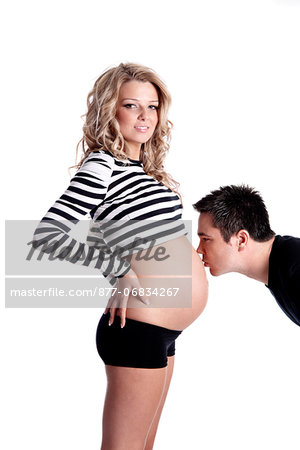 Man kissing stomach of pregnant woman Stock Photo - Rights-Managed, Image code: 877-06834267