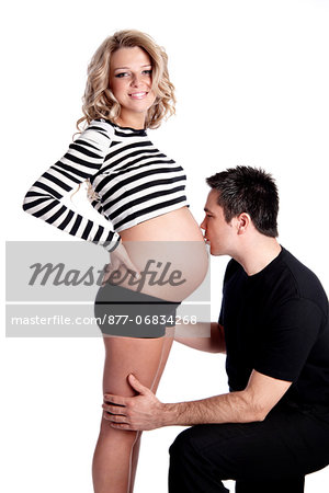 Man kissing stomach of pregnant woman Stock Photo - Rights-Managed, Image code: 877-06834268