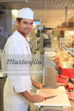 France, supermarket, young butcher. Stock Photo - Rights-Managed, Image code: 877-06835752