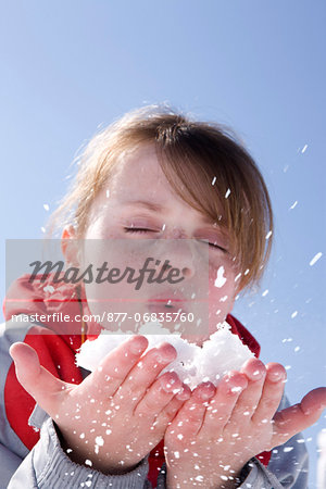 France, winter girl portrait blowing snow Stock Photo - Rights-Managed, Image code: 877-06835760