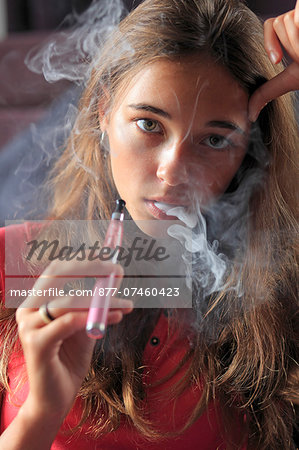 France, young girl smoking an electronic cigarette Stock Photo - Rights-Managed, Image code: 877-07460423
