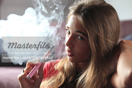 France, young girl smoking an electronic cigarette Stock Photo - Rights-Managed, Image code: 877-07460424
