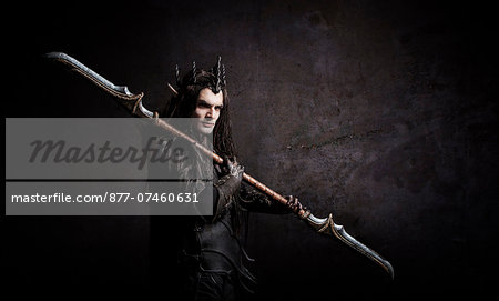Dark Elf with a spear over shoulder Stock Photo - Rights-Managed, Image code: 877-07460631