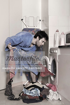 a man empties the washing machine Stock Photo - Rights-Managed, Image code: 877-08026441