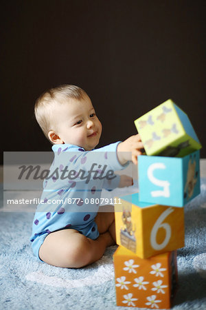 A 15 months baby boy playing with cubes Stock Photo - Rights-Managed, Image code: 877-08079111