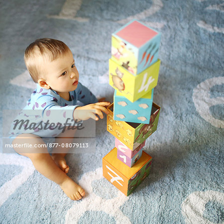 A 15 months baby boy playing with cubes Stock Photo - Rights-Managed, Image code: 877-08079113