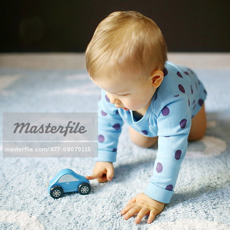 A 15 months baby boy playing with a car Stock Photo - Rights-Managed, Image code: 877-08079115