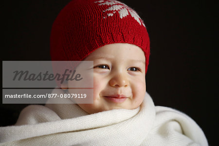 A 15 months baby boy with a cap and a scarf Stock Photo - Rights-Managed, Image code: 877-08079119