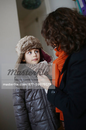 A mom dressing her 5 years old boy before to go outside Stock Photo - Rights-Managed, Image code: 877-08079179