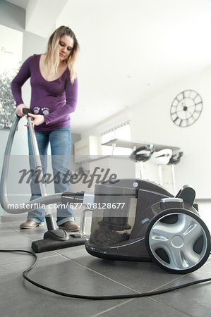France, pregnant woman at home passing vacuum cleaner. Stock Photo - Rights-Managed, Image code: 877-08128677