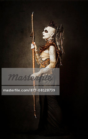 Tribal warrior standing in profile, with a spear Stock Photo - Rights-Managed, Image code: 877-08128739