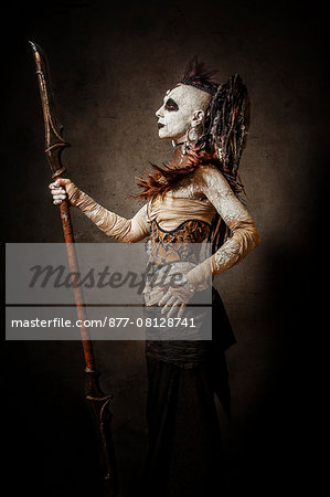 Tribal warrior standing in profile, with a spear Stock Photo - Rights-Managed, Image code: 877-08128741