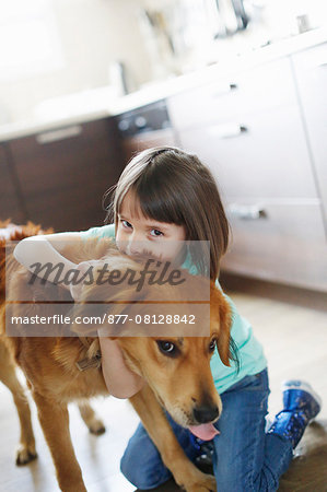 Girl playing with a dog Stock Photo - Rights-Managed, Image code: 877-08128842