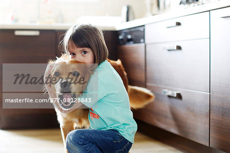 Girl playing with a dog Stock Photo - Rights-Managed, Image code: 877-08128843