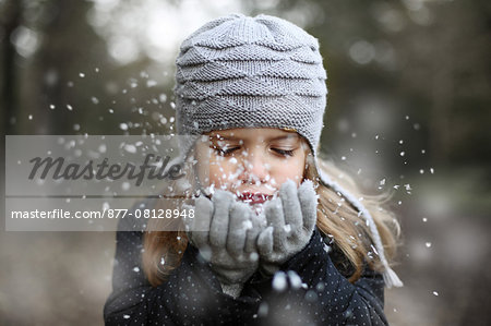 Girl holding snow in her hands Stock Photo - Rights-Managed, Image code: 877-08128948