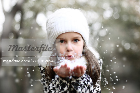 Girl holding snow in her hands Stock Photo - Rights-Managed, Image code: 877-08128949