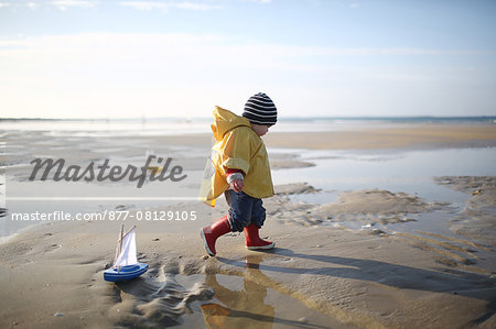 A 1 year old boy plays on the beach Stock Photo - Rights-Managed, Image code: 877-08129105