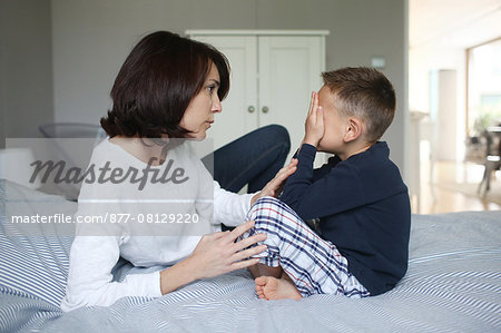 A mom consoling her 5 years old son Stock Photo - Rights-Managed, Image code: 877-08129220