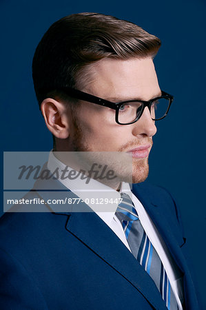 man in blue suit, tie, beard; blue background, glasses Stock Photo - Rights-Managed, Image code: 877-08129447