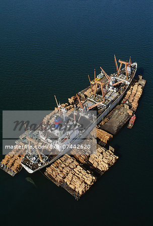 Rainforest lumber loaded on freighter, an aerial view of the timber on rafts and on board, in Sandakan, Borneo Stock Photo - Rights-Managed, Image code: 878-07442620