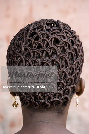 A woman's head with braided patterned hair and earrings. Stock Photo - Rights-Managed, Image code: 878-07442662