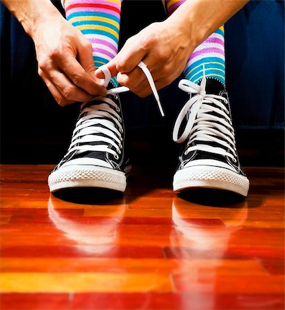 Close up of a teenager tying his footwear Stock Photo - Budget Royalty-Free & Subscription, Code: 400-04004276