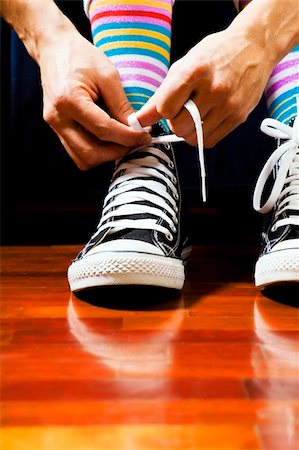 Close up of a teenager tying his footwear Stock Photo - Budget Royalty-Free & Subscription, Code: 400-04005112
