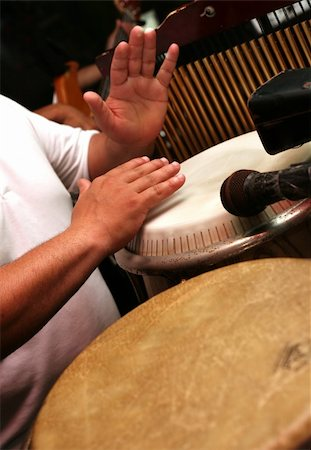 Man playing the djembe (nigerian drum) Stock Photo - Budget Royalty-Free & Subscription, Code: 400-04005451