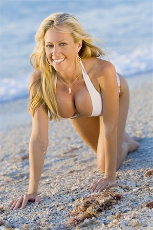 simsearch:400-04002563,k - A beautiful bikini clad blond crawls up a beach in golden sunlight Stock Photo - Budget Royalty-Free & Subscription, Code: 400-04005980