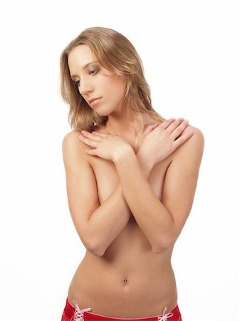 Young blond woman with arms over breasts Stock Photo - Budget Royalty-Free & Subscription, Code: 400-04009027