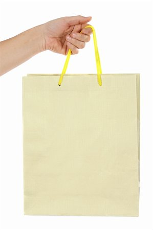 Hand whit bag a over white background Stock Photo - Budget Royalty-Free & Subscription, Code: 400-04009552
